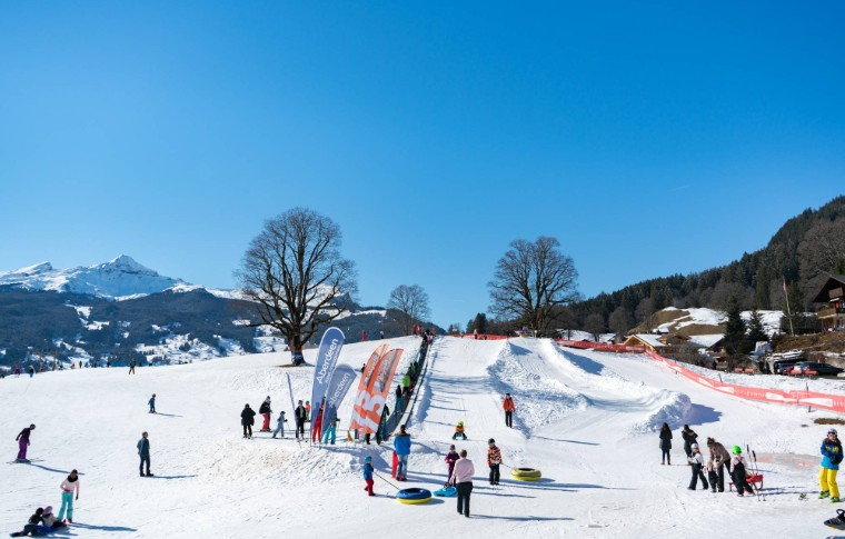 ski track with several people and tubes having fun in the snow