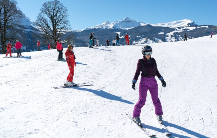 new skiers practicing what they learned in the course