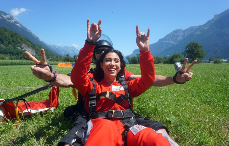 tour goer and guide recently landed and making the peace sign with their hands