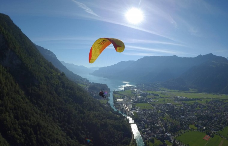 person paragliding over the river