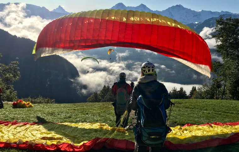 tour goers waiting for their turn to paraglide