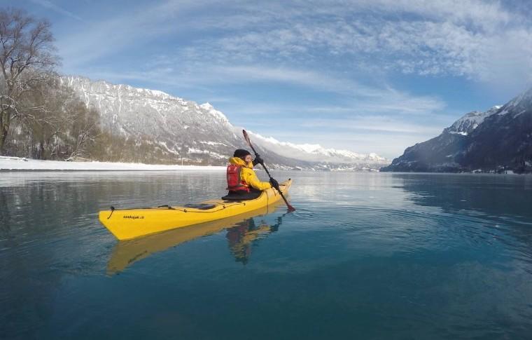 tour goer winter kayaking on the lake